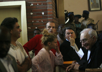 Members of Zoe's Ark stand with their lawyers during their trial at the Justice Palace in N'Djamena