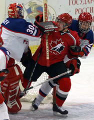 RUSSIAN GOALIE MEDVEDEV HITS LUNDMARK OF CANADA DURING THEIR U20 WORLD CHAMPIONSHIP ICE HOCKEY MATCH ...