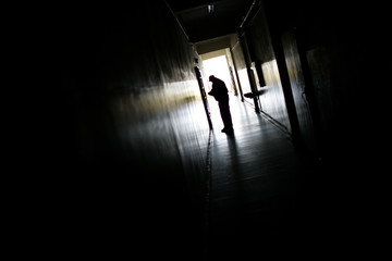 Security personnel walks in a corridor in a school in the Roma suburb of Fakulteta in Sofia
