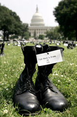 """Combat boots bearing the names of some 800 U.S. soldiers killed in Iraq form an exhibit called """"Eyes.."""