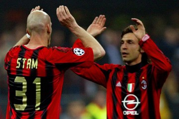 AC Milan's Stam is congratulated by his team mate Pirlo after scoring against Inter Milan during ...