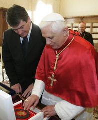 Pope Benedict XVI exchanges gifts with Albanian President Bamir Topi during a meeting  at the Vatican
