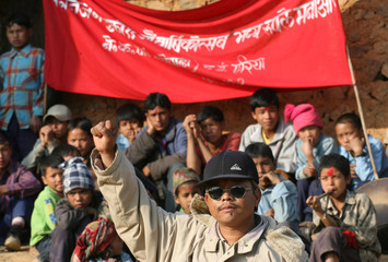 Maoist Rolpa district governor salutes during celebrations in western Nepal