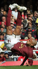 Arsenal's Henry falls after attempting an overhead kick on goal during their English Premier League soccer match against Aston Villa in London