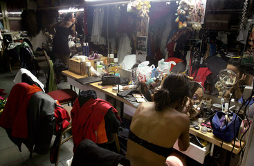 Performers at Singapore's Boom Boom Room drag comedy club prepare for the evening's performance.
