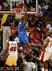 Orlando Magic Howard dunks over Miami Heat defenders during NBA action in Florida