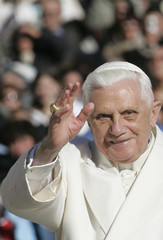 Pope Benedict XVI waves to the faithful as he arrive to lead an audience with Italy's religious brotherhoods in Saint Peter's square at the Vatican