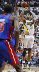 Indiana Pacers forward Granger shoots over Detroit Pistons forward Johnson during the fourth quarter of their NBA basketball game in Indianapolis