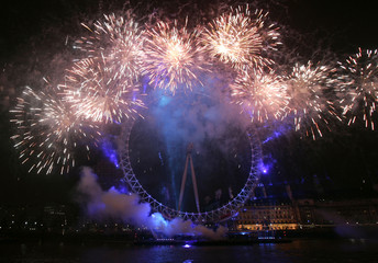 Fireworks explode in front of the London Eye on the River Thames in London to celebrate the New Year