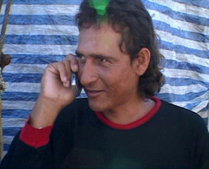 Video grab shows Mexican fisherman Randon talking to his family on mobile phone after arriving in Marujo