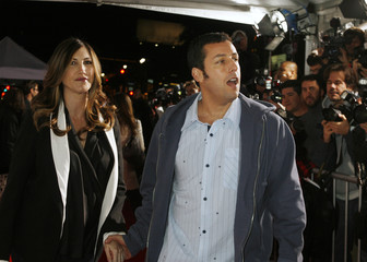 """Actor Sandler and wife Jackie arrive at the premiere of the film """"Bedtime Stories"""" in Hollywood"""