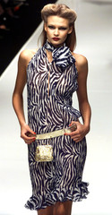 A model wears a zebra print dress as part of Rocco Barocco Spring/Summer ready-to-wear women's colle..