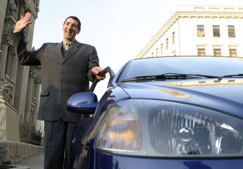 Stadnyk of Ukraine, named as the world's tallest man by the Guinness World Records, poses for a picture next to a car in Kiev
