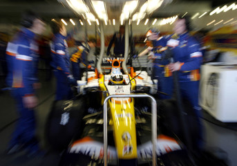 Renault Formula One driver Fernando Alonso of Spain sits in his car at the Jerez racetrack in southern Spain