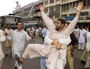 PAKISTANI POLICE ARREST AN ISLAMIST ANTI-GOVERNMENT DEMONSTRATOR IN KARACHI.
