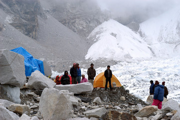 THE MEMBERS OF THE VARIOUS EXPEDITIONS WAIT AT THE EVEREST BASE CAMPFOR THEIR RESPECTIVE TEAMS TO ...