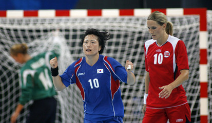 Oh Seong-ok of South Korea celebrates after scoring during their women's handball semi-final match against Norway at the Beijing 2008 Olympic Games