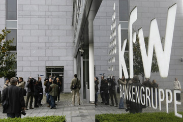 Journalists wait outside the local branch of the KfW bank in Frankfurt