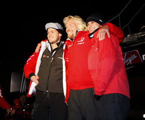 """Richard Branson stands with his children Sam and Holly on the boat """"Virgin Money"""" before they depart New York"""