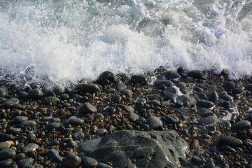 sea foam wave on the rocks