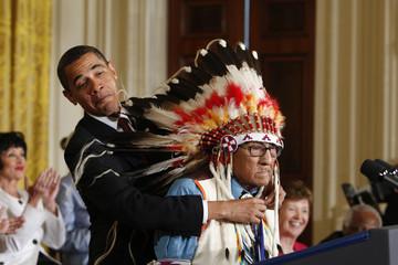 U.S. President Barack Obama presents the Medal of Freedom to Joe Medicine Crow - High Bird during a ceremony in Washington.