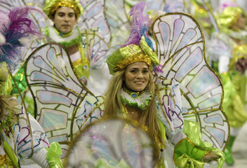 Revellers of the Sao Clemente samba school dance during the first night of parades by the top samba groups in Rio de Janeiro's Sambadrome
