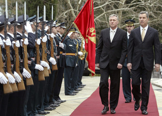 Czech Republic's PM Mirek Topolanek and his Montenegrin counterpart Djukanovic review the guard of honour in Podgorica