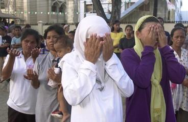 FILIPINO MUSLIM WOMEN PRAY IN ZAMBOANGA CITY.