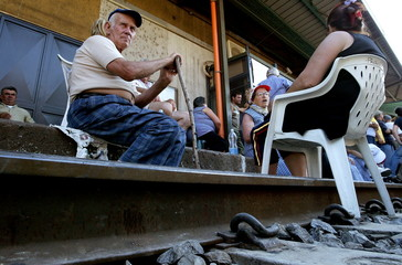Elderly people are seated in the middle of the railway line as they protests at the Montecorvino Rov..