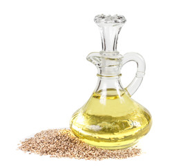 Sesame seeds and oil isolated on white background