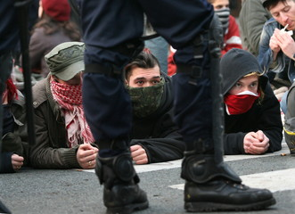 Protestors stage a sitting before being arrested by policemen during clashes at the end of a student..