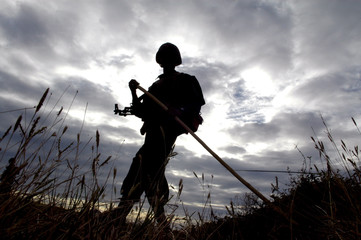 Army soldier patrols and looks for explosion device on the main road in Punani, Sri Lanka