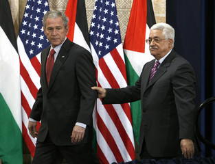 U.S. President Bush and Palestinian President Abbas arrive to speak to reporters in Ramallah
