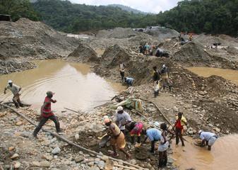 Colombian gold prospectors mine for precious metal on the river Dagau, Zaragoza province, Cauca