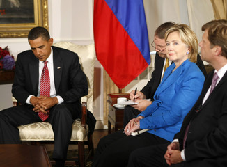 U.S. Secretary of State Hillary Clinton looks up during a meeting between U.S. President Barack Obama and Russian President Dmitry Medvedev in New York