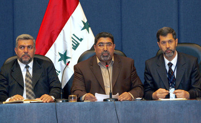Head of the Al-Sadr parliamentary bloc Nassar Al-Rubai speaks during a news conference in Baghdad