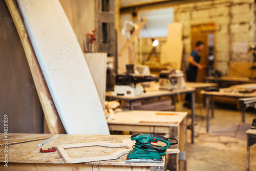 Background Image Of Woodworking Shop Working Tables And Tools In