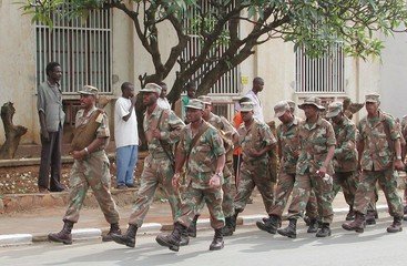 SOUTH AFRICAN TROOPS WATCH THE STREETS.