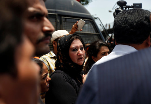 Shaimaa Salim, sister of Eman Ahmed, an Egyptian woman who underwent weight loss surgery, reacts while speaking to reporters outside a hospital in Mumbai