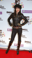 Juliette Lewis poses on the red carpet before the MTV Europe Awards ceremony in Berlin