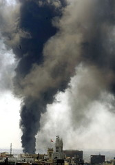 A huge column of smoke raises over central Madrid after an electricity substation caught fire July 1..