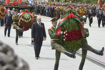Belarussian President Alexander Lukashenko takes part in a wreath laying ceremony at Victory square in Minsk