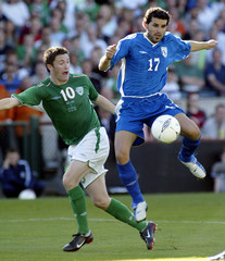 Irelands Keane is beaten to the ball by Cyprus Ilia during World Cup 2006 qualifying match at Lansdowne ...