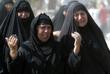 Women cry during the funeral of a member of Shi'ite's Mehdi army in Baghdad's Sadr city