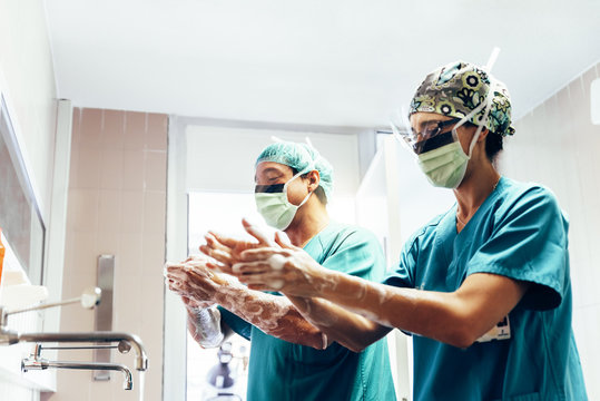 Couple of Surgeons Washing Hands Before Operating.