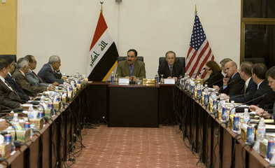 Iraq's Deputy Prime Minister Essawi and Ambassador Mare Wall, U.S. Embassy's Coordinator for Economic Transition in Iraq, hold meeting in Baghdad