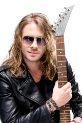 handsome rocker in sunglasses posing with electric guitar isolated on white, electric guitar player concept