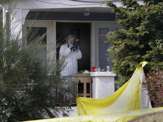Seattle police photographs the scene where seven people were shot and killed in a house in the Capital Hill neighborhood