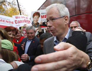 Liberal leader Stephane Dion laughs as he meets supporters after a rally in the Montreal suburb of Longueuil