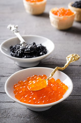 Black and red caviar, appetizer in white bowls